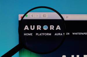 Aurora logo under magnifying glass
