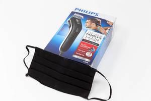 Ausrüstung für Corona-Zeiten: schwarzer Mundschutz und Haarschneider Philips QC5115/15 von Philips