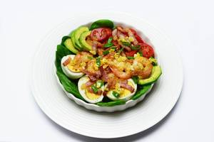 Avocado salad, shrimp, bacon, tomatoes and spinach