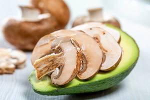 Avocado stuffed with mushrooms