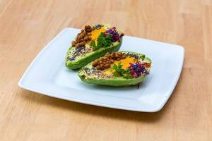 Avocado with Pumpkin Humus, Lentil, Chia and coloured herbs