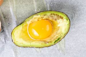 Avocado with raw Eggs ready for baking (Flip 2019)