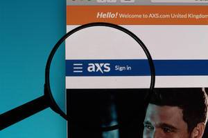 AXS.com logo under magnifying glass