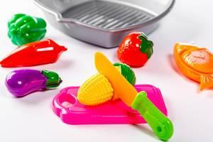Baby toys vegetables on white background