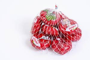 Babybel cheese in the bag above white background