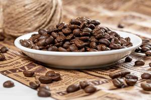 Background of coffee beans on newspaper (Flip 2019)