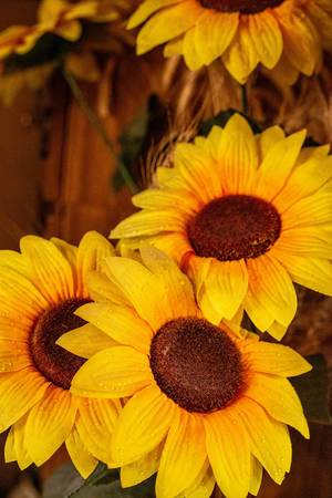 Background with a bouquet of yellow sunflowers