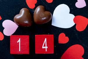 Background with chocolates and date 14 for Valentine