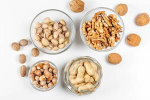 Background with different types of nuts in the skin and without (Flip 2020)