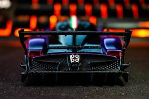Backside of a mini sports car on black surface (Flip 2019)