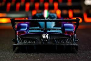 Backside of a mini sports car on black surface