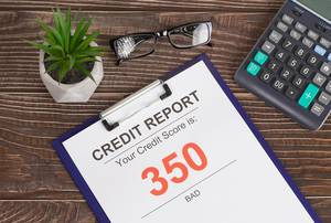 Bad credit score report of 350 on office table