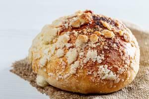 Baked bun with sugar crumbs on burlap (Flip 2019)