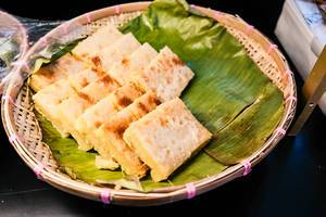 Baked cassava cake on weaved basket