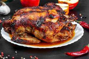 Baked chicken stuffed with apples with spices, chili and fresh apples