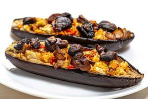 Baked eggplant halves with mushrooms, vegetables and couscous