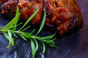 Baked meat with a rosemary