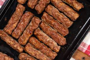 Baked minced meat Kebabs on the baking pan