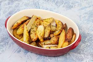 Baked Potatoes served in the bowl on the table (Flip 2019)