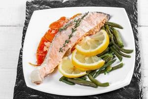 Baked salmon garnished with asparagus and carrot with herbs (Flip 2019)
