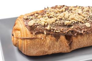 Bakery Pastry with Chocolate Cream and grated Hazelnuts