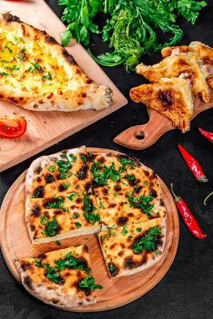 Baking background with three kinds of khachapuri - meat, cheese and Adygei khachapuri