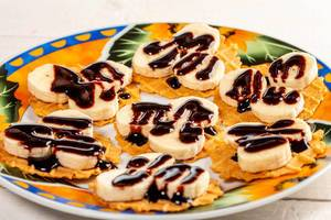 Banana waffle with chocolate on plate (Flip 2019)
