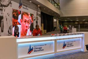 Bank of America Chicago Marathon staff at welcome desk inside the North Building of the McCormick Place Convention Center