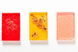 Bars of handmade soap with natural oils on white background. Top view