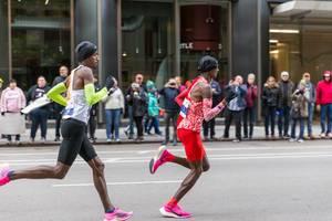 Bashir Abdi and Sir Mo Farah at the Chicago Marathon 2019: last year