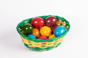 Basket full of painted Easter eggs