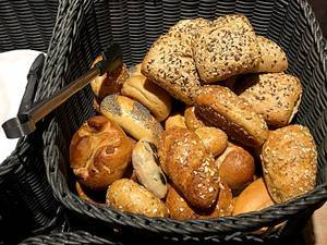 Basket with different kinds of Bread Rolls including wholegrain and poppy