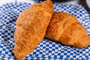 Beautiful and delicious croissants with fruit jam