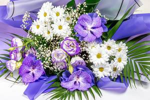 Beautiful bouquet of flowers with purple orchids and white chrysanthemums (Flip 2019)