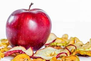 Beautiful red Apple on the background with dried apples