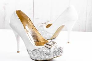 Beautiful wedding shoes with heels on white background (Flip 2019)