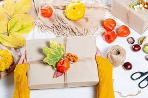Beautifully packaged gift in autumn style in women