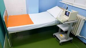 Bed and ultrasound device at a clinical department for gynecology and obstetrics  Flip 2019