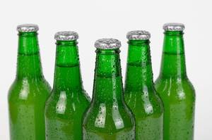 Beer bottles stacked isolated on white background
