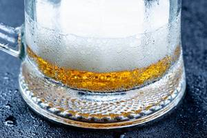Beer glass with light beer close-up