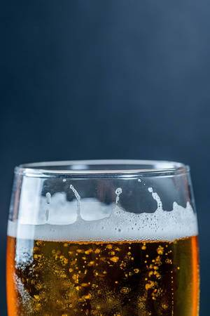 Beer in a glass on a dark background