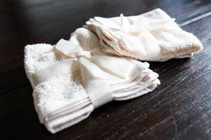 Beige towels on wooden table