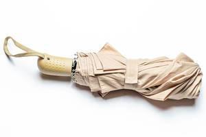 Beige umbrella on a white background, top view (Flip 2020)
