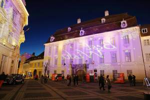 Best Wishes message, light reflection on buildings for Christmas holidays, Sibiu (Flip 2019)