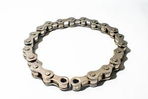 Bicycle chain on white surface