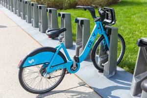 Bike sharing in the US: a blue bicycle from the Chicago bike rental system Divvy locked at a station