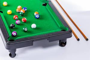 Billiard table with balls and billiard cue