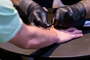 Biohax implants NFC Chips to Attendees of Digital X in Cologne