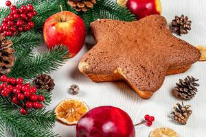 Biscuit in form star on the table with apples, dried citrus and Christmas decor (Flip 2019)