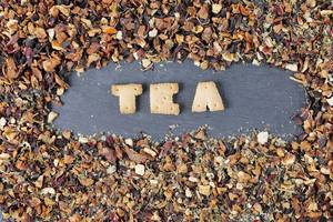Biscuit letters, Tea, among dry tea leaves